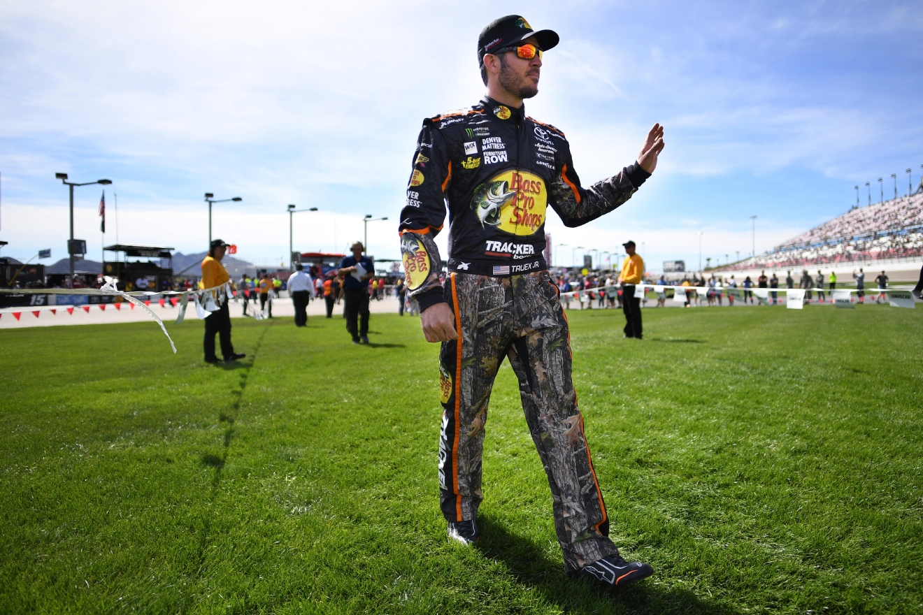 Eventual race winner Martin Truex Jr. makes his way across the infield for driver introductions during the Monster Energy NASCAR Cup Series Kobalt 400 Sunday, March 12, 2017, at the Las Vegas Motor Speedway. (Sam Morris/Las Vegas News Bureau)