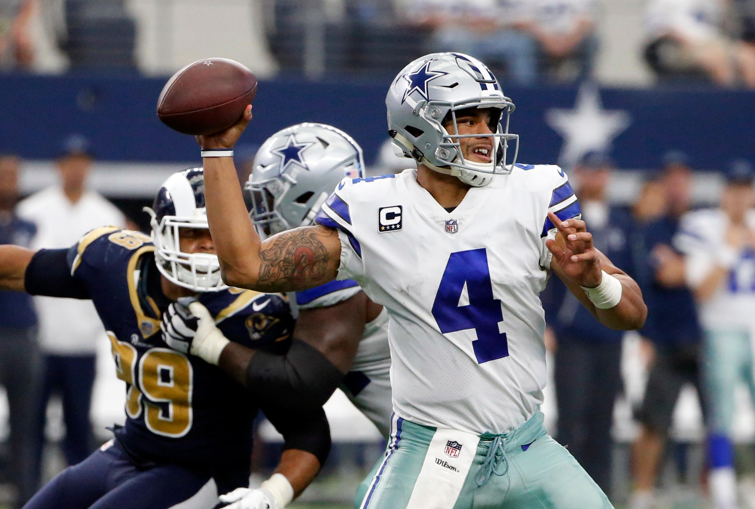 Dallas Cowboys quarterback Dak Prescott (4) throws a pass in the second half of an NFL football game against the Los Angeles Rams on Sunday, Oct. 1, 2017, in Arlington, Texas. (AP Photo/Michael Ainsworth)