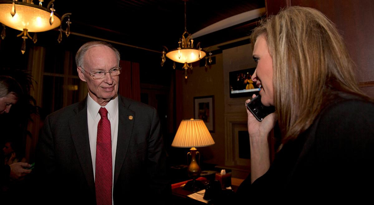 FILE -In this Tuesday, Nov. 4, 2014 file photo, Republican Gov. Robert Bentley listens to a  phone call as Rebekah Mason, right, announces his win for Alabama governor, in Montgomery, Alabama. Bentley has testified before a grand jury, according to a person briefed on his appearance. The revelation comes a day before legislators were to meet to push forward with efforts to impeach him over his relationship with a former aide. (AP Photo/Brynn Anderson, File)
