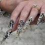 These nails are bedazzled in all kinds of metal jewelry