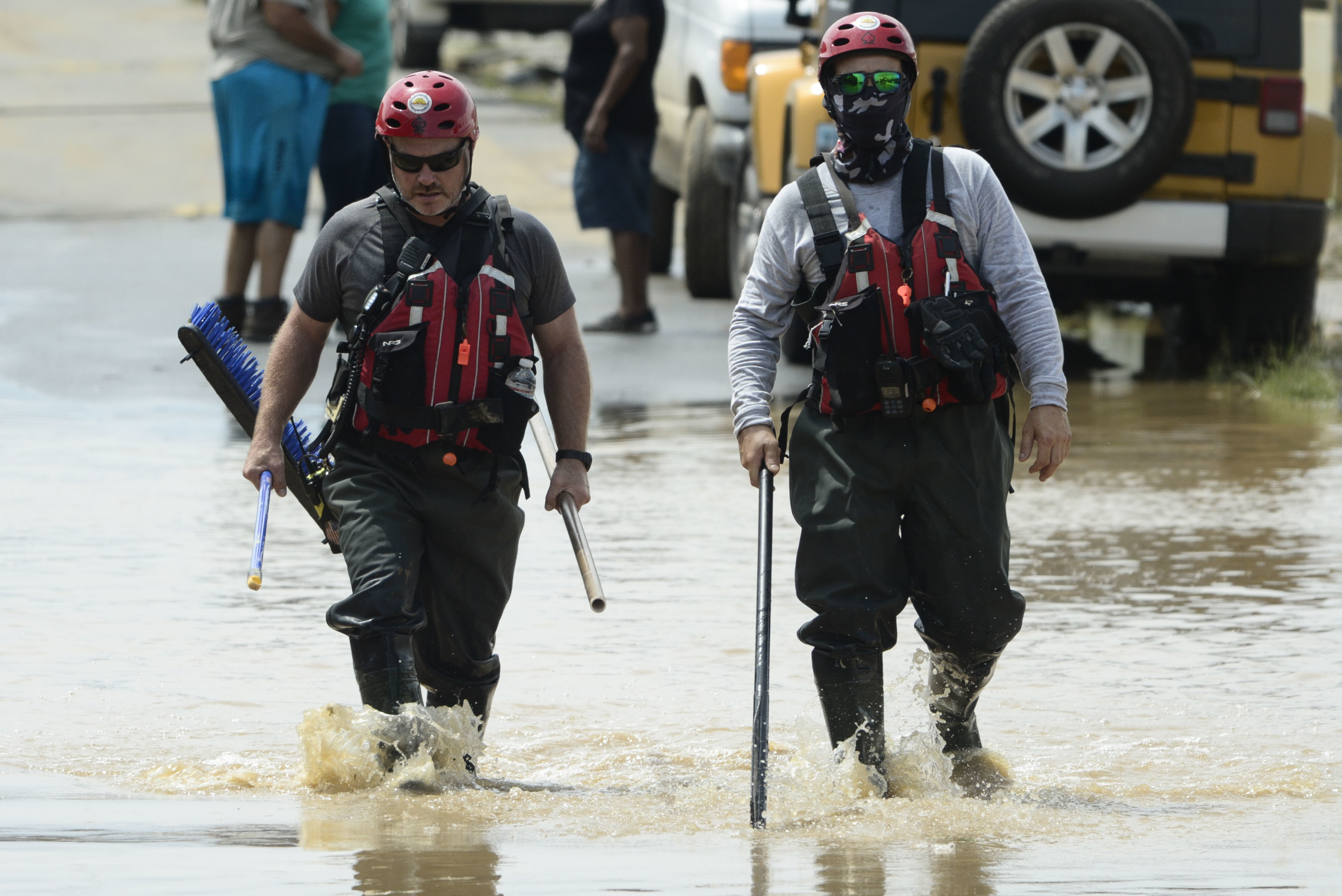 Personnel from a FEMA search and rescue crew walk in a flooded road, after the passing of Hurricane Maria, in Toa Baja, Puerto Rico, Friday, September 22, 2017. Because of the heavy rains brought by Maria, thousands of people were evacuated from Toa Baja after the municipal government opened the gates of the Rio La Plata Dam. (AP Photo/Carlos Giusti)