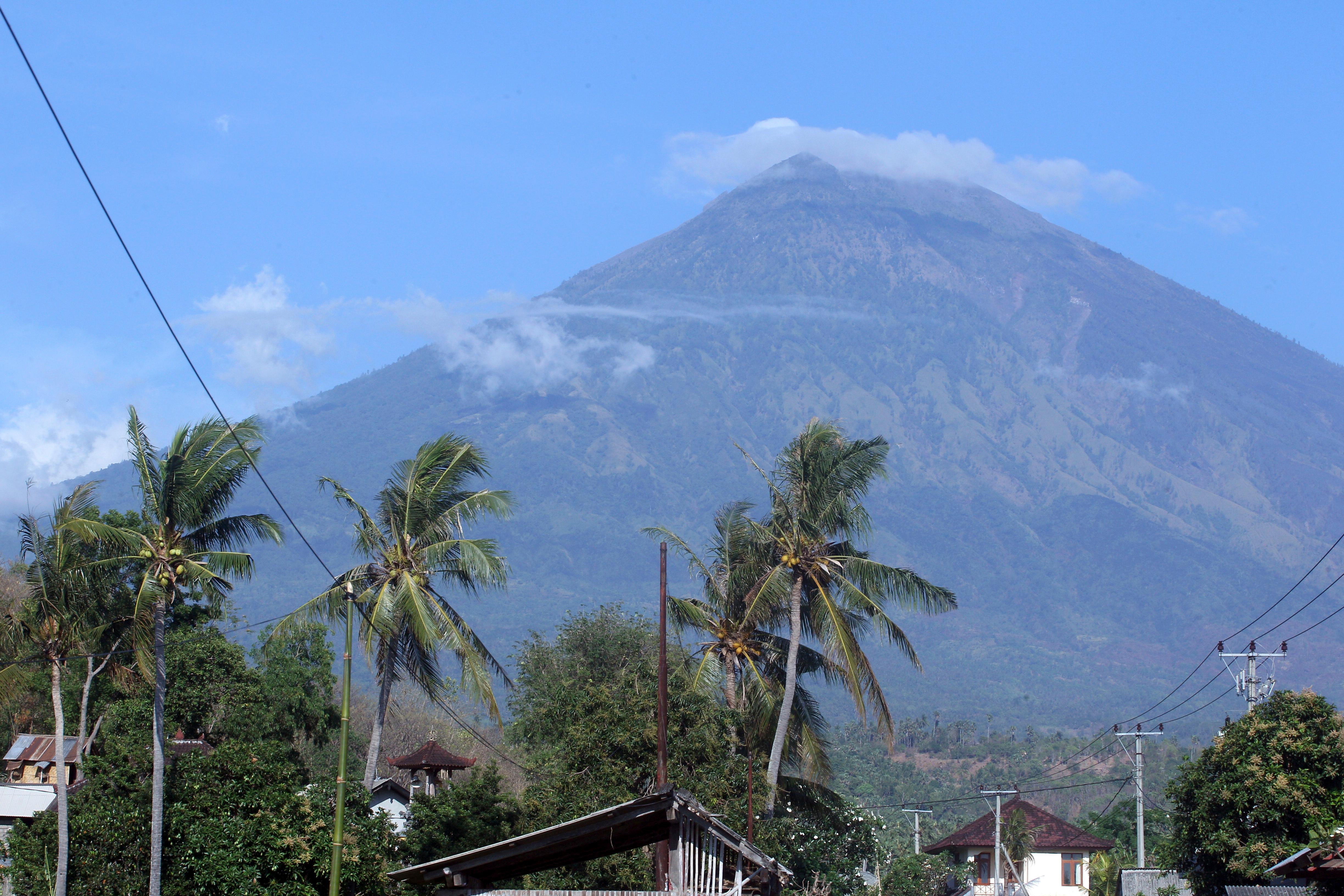 Mount Agung volcano is seen in Amed, Bali, Indonesia, Tuesday, Sept. 26, 2017. An increasing frequency of tremors from the volcano indicates magma is continuing to move toward the surface and an eruption is possible, a disaster agency official said Tuesday. Tourists are cutting short their stay to the island, where an eruption would force the airport to close and strand thousands. (AP Photo/Firdia Lisnawati)