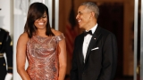 Michelle Obama shines in Versace at White House dinner