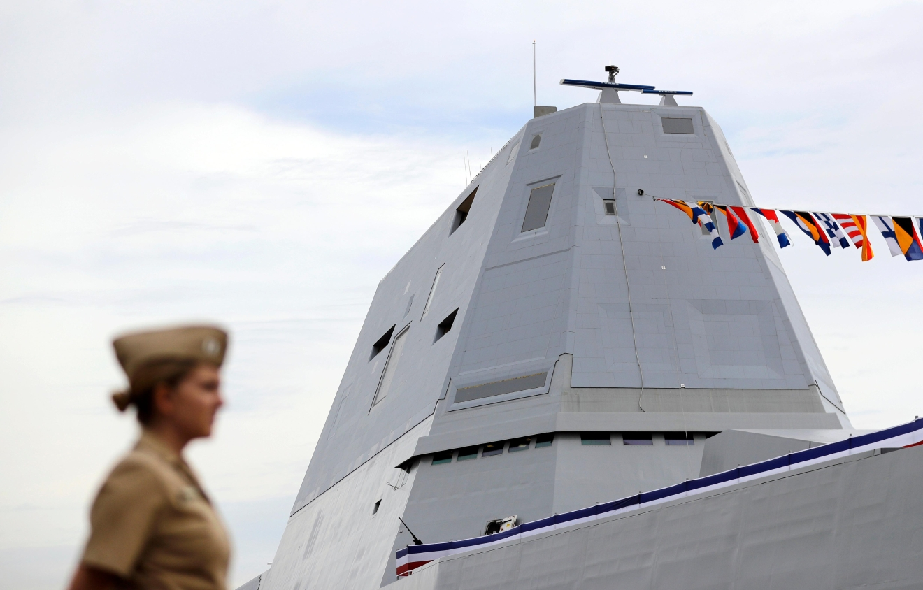 In this Oct. 13, 2016 photo, the deckhouse of the future USS Zumwalt, the U.S. Navy's newest guided-missile destroyer, is seen past a member of the U.S. Navy in Baltimore. Designed and built with an angular shape to minimize its radar signature, it's the most expensive destroyer ever built for the Navy. (AP Photo/Patrick Semansky)