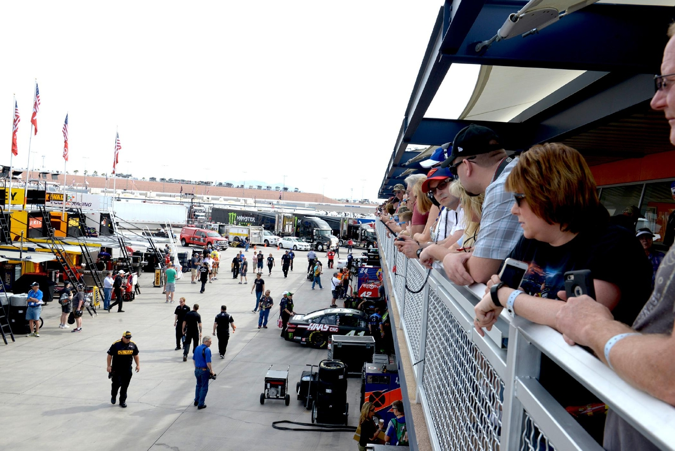 Fans crowd the rail above the NEON Garage to see their favorite drivers head for the track during NASCAR Stratosphere Pole Day at Las Vegas Motor Speedway. Friday, March 10, 2017. (Glenn Pinkerton/Las Vegas News Bureau)