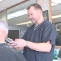 Barber shop opens on traditional day off to help community member