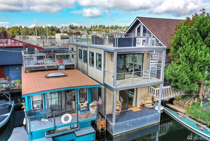"The only thing more beautiful than this houseboat on Lake Union is its views from the rooftop! This floating home in Eastlake features two bedrooms and 1.5 bathrooms, is 900 square feet and oozes{&nbsp;}modernity. It's also got a rooftop deck with views of the city and is listed by{&nbsp;}Javila Creer of{&nbsp;}Windermere for $779,000.{&nbsp;}<a  href=""https://www.windermere.com/listing/WA/Seattle/2727-Fairview-Ave-E-a-3-98102/117188616?fbclid=IwAR1IoZ8cyEcQtLNXSATw99cQLf7Eu38uqEJX4yOXlAex-U5SyHyz2YQgy20"" target=""_blank"" title=""https://www.windermere.com/listing/WA/Seattle/2727-Fairview-Ave-E-a-3-98102/117188616?fbclid=IwAR1IoZ8cyEcQtLNXSATw99cQLf7Eu38uqEJX4yOXlAex-U5SyHyz2YQgy20"">More info online</a>. (Image: Courtesy of Javila Creer/Windermere)"
