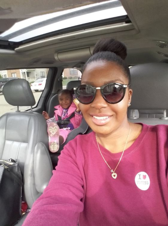 Octavia Williams went to vote with her young daughter