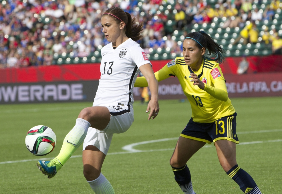 United States Alex Morgan 13 Kicks The Ball In Front OfColombias Angela Clavijo During First Half FIFA Womens World Cup Round Of 16 Action