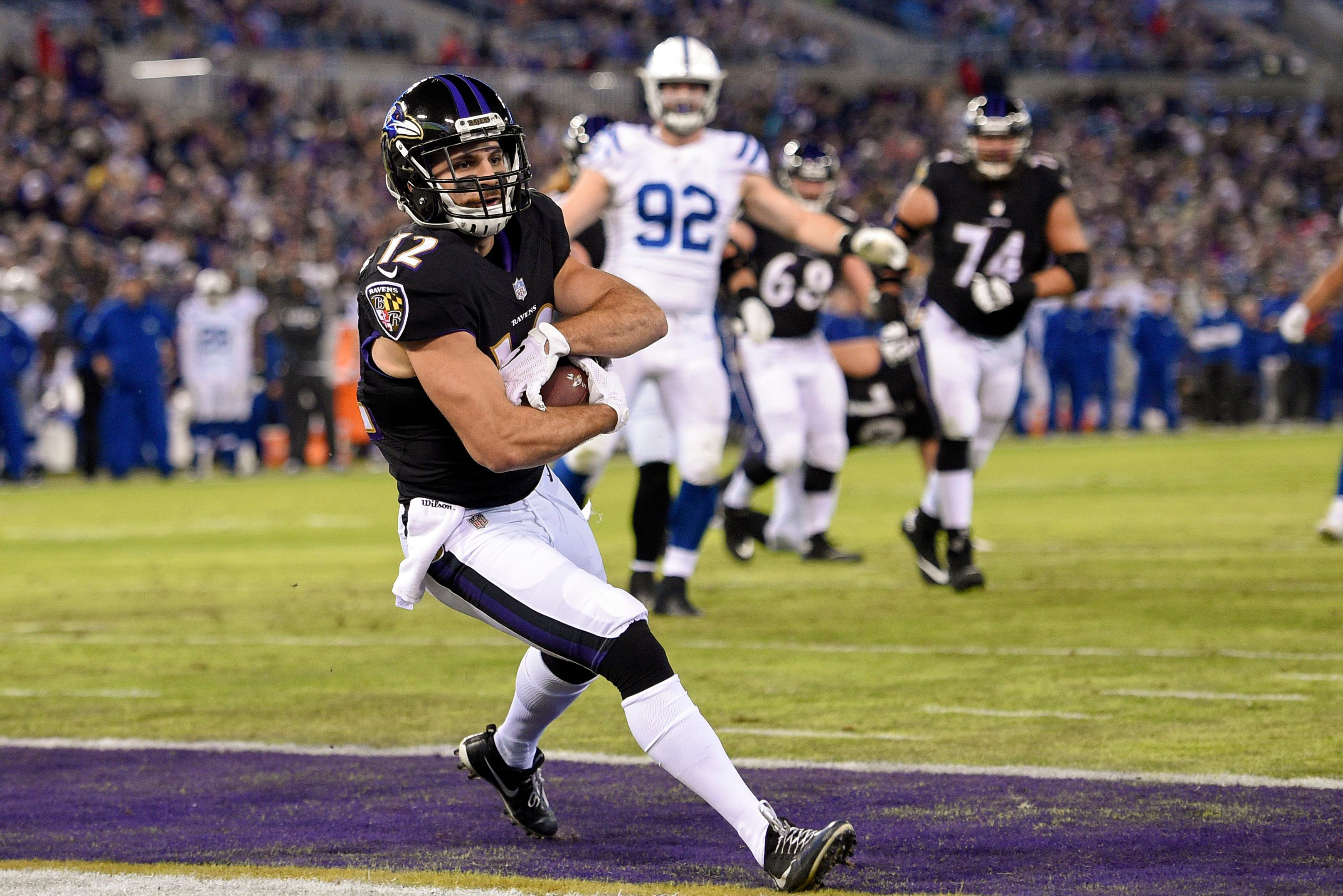 Baltimore Ravens wide receiver Michael Campanaro (12) lands in the end zone for a touchdown on a pass reception during the first half of an NFL football game against Indianapolis Colts in Baltimore, Saturday, Dec 23, 2017. (AP Photo/Nick Wass)
