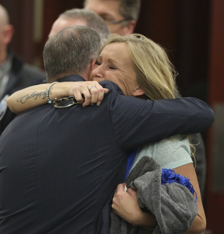 <p>Tammy Weeks, right, mother of victim Nicole Lovell, hugs Chief Deputy Commonwealth's Attorney Patrick Jensen after David Eisenhauer pleaded no contest in Montgomery County Circuit Court in Christiansburg, Va., Friday, Feb. 9 2018. Eisenhauer, a former Virginia Tech student, pleaded no contest on Friday, in the 2016 killing of a 13-year-old girl. A plea of no contest means a defendant acknowledges there's enough evidence to convict him, but doesn't admit he committed the crime. The plea has the same effect as a guilty plea. (Matt Gentry/The Roanoke Times via AP, Pool)</p>