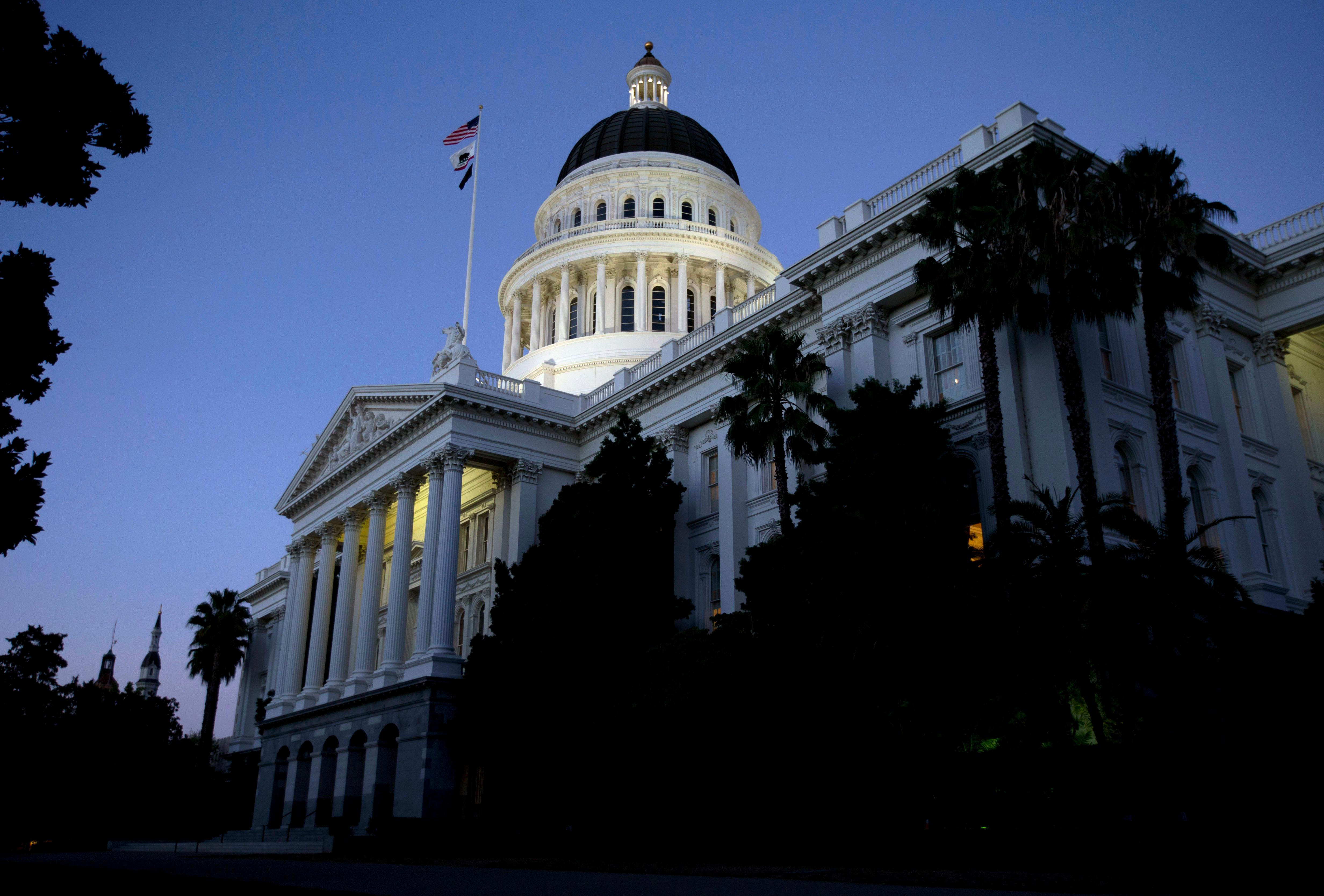 FILE -- In this Aug. 31, 2016 file photo the dome of the state Capitol glows in the early evening in Sacramento, Calif.  California lawmakers return Monday, Aug. 21 , from a monthlong break with a busy agenda that includes tackling the state's housing crisis and deciding whether to make California a statewide sanctuary for people living illegally in the U.S.(AP Photo/Rich Pedroncelli, file)