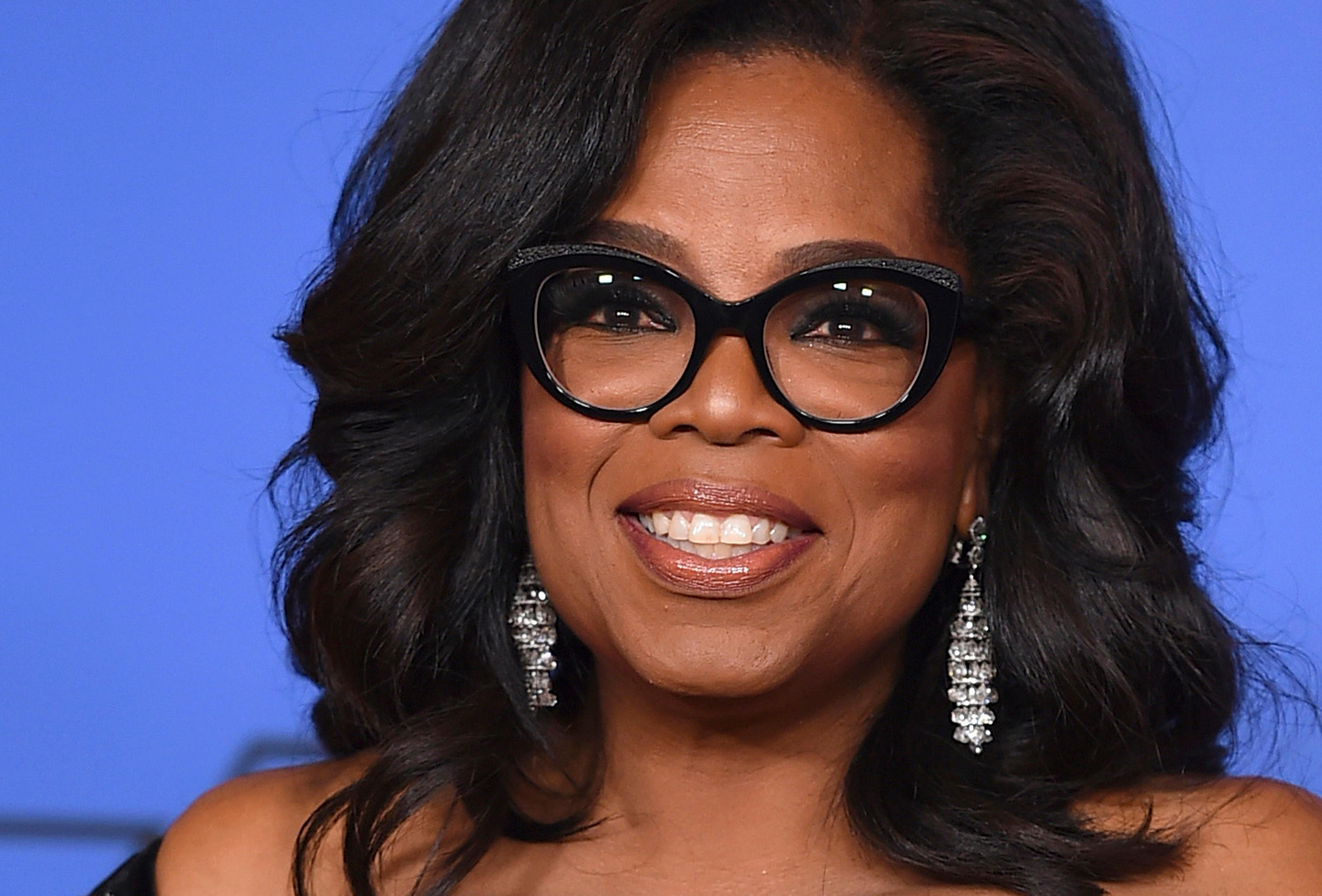 FILE - In this Jan. 7, 2018, file photo, Oprah Winfrey poses in the press room with the Cecil B. DeMille Award at the 75th annual Golden Globe Awards in Beverly Hills, Calif. In the final days in one of the nation's hottest governor's races, Oprah Winfrey and President Donald Trump, as well as former Presidents Barack Obama and Jimmy Carter and Vice President Mike Pence, are trying to put their imprint on the Georgia election. Winfrey joins Democratic nominee Stacey Abrams for two town hall-style events Thursday, the same day that Pence travels to the state for several rallies with Republican Brian Kemp. (Photo by Jordan Strauss/Invision/AP, File)