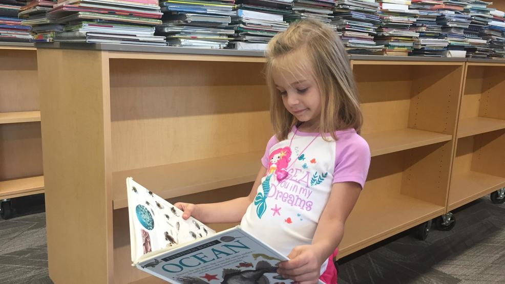 Harrison Elementary moves books into New Library with a Book