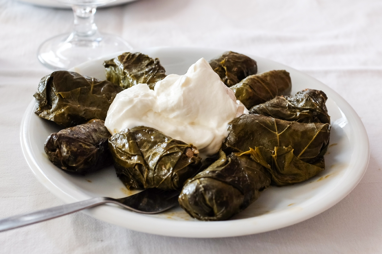 Stuffed grape leaves, or dolmas, served with a sizable dollop of yogurt.  It is widely held that one of the best ways to get to know a new place or culture is to indulge in its cuisine. I recently spend a few days in Athens and the Greek island of Crete, and I have to say - all the beach hopping makes a girl hungry! Eating my way to enlightenment is nothing I have a problem with. From moussaka to souvlaki, here's a little food diary from my Grecian vacation. (Image: Chona Kasinger / Seattle Refined)