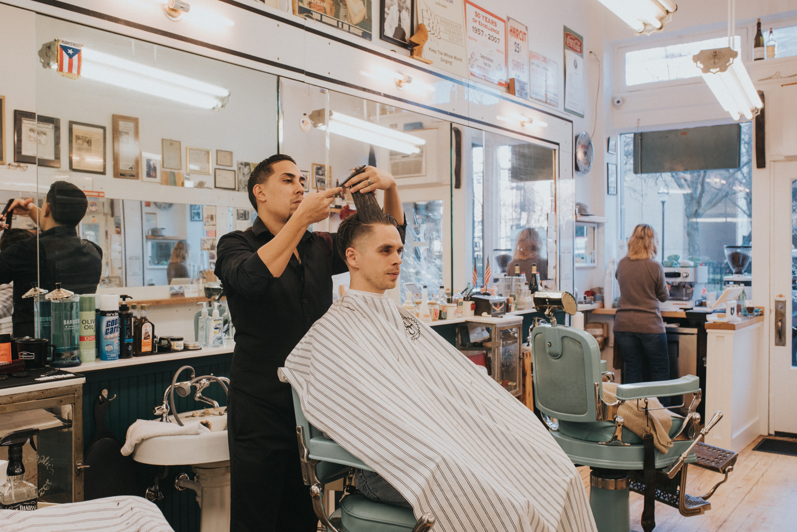 Barber Felix cutting Levi's hair / Image: Brianna Long // Published: 12.29.17