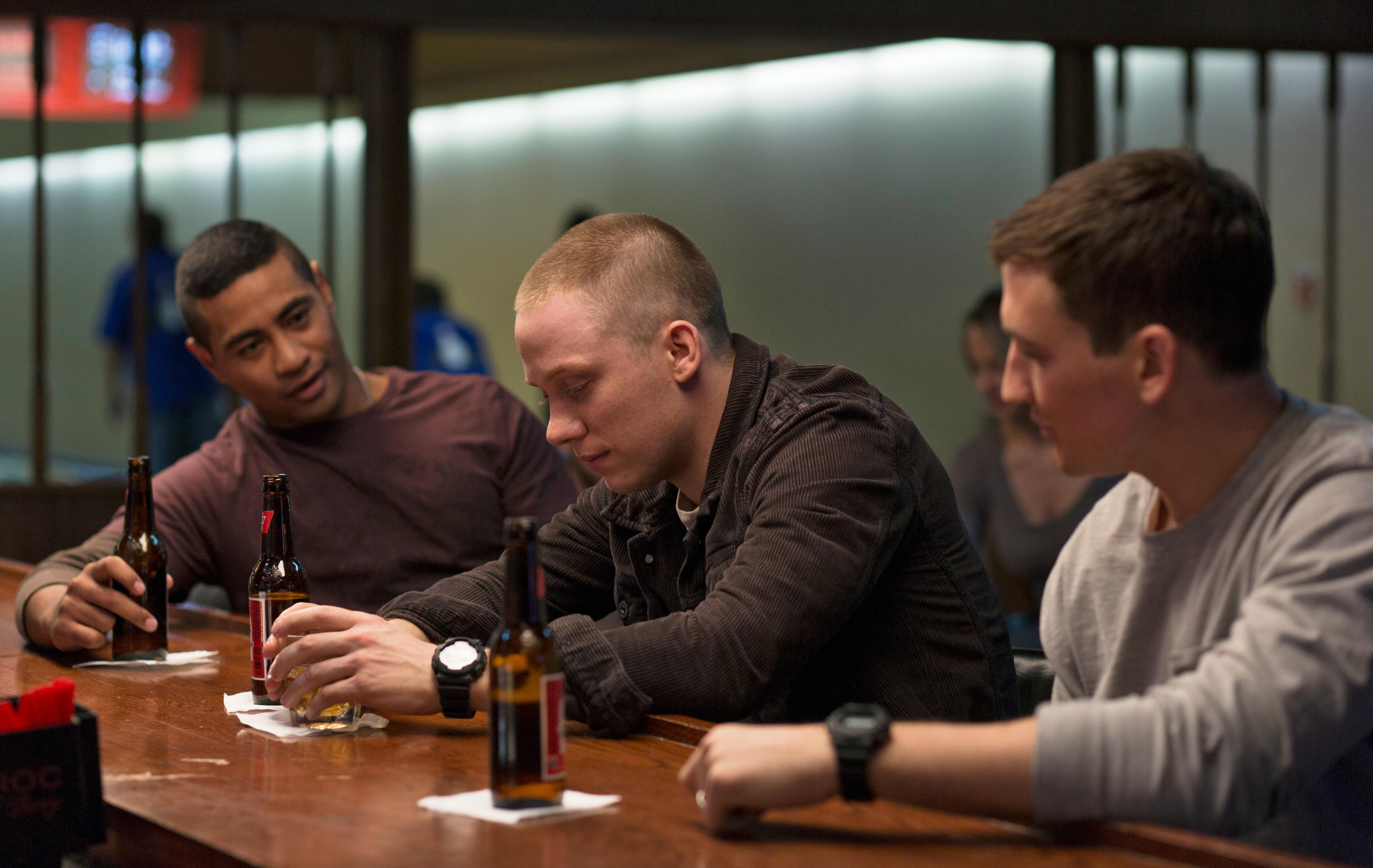 "(L to R) Solo Aeiti (BEULAH KOALE), Will Waller (JOE COLE) and Adam Schumann (MILES TELLER) in DreamWorks Pictures' ""Thank You for Your Service.""  The drama follows a group of U.S. soldiers returning from Iraq who struggle to integrate back into family and civilian life, while living with the memory of a war that threatens to destroy them long after they've left the battlefield."