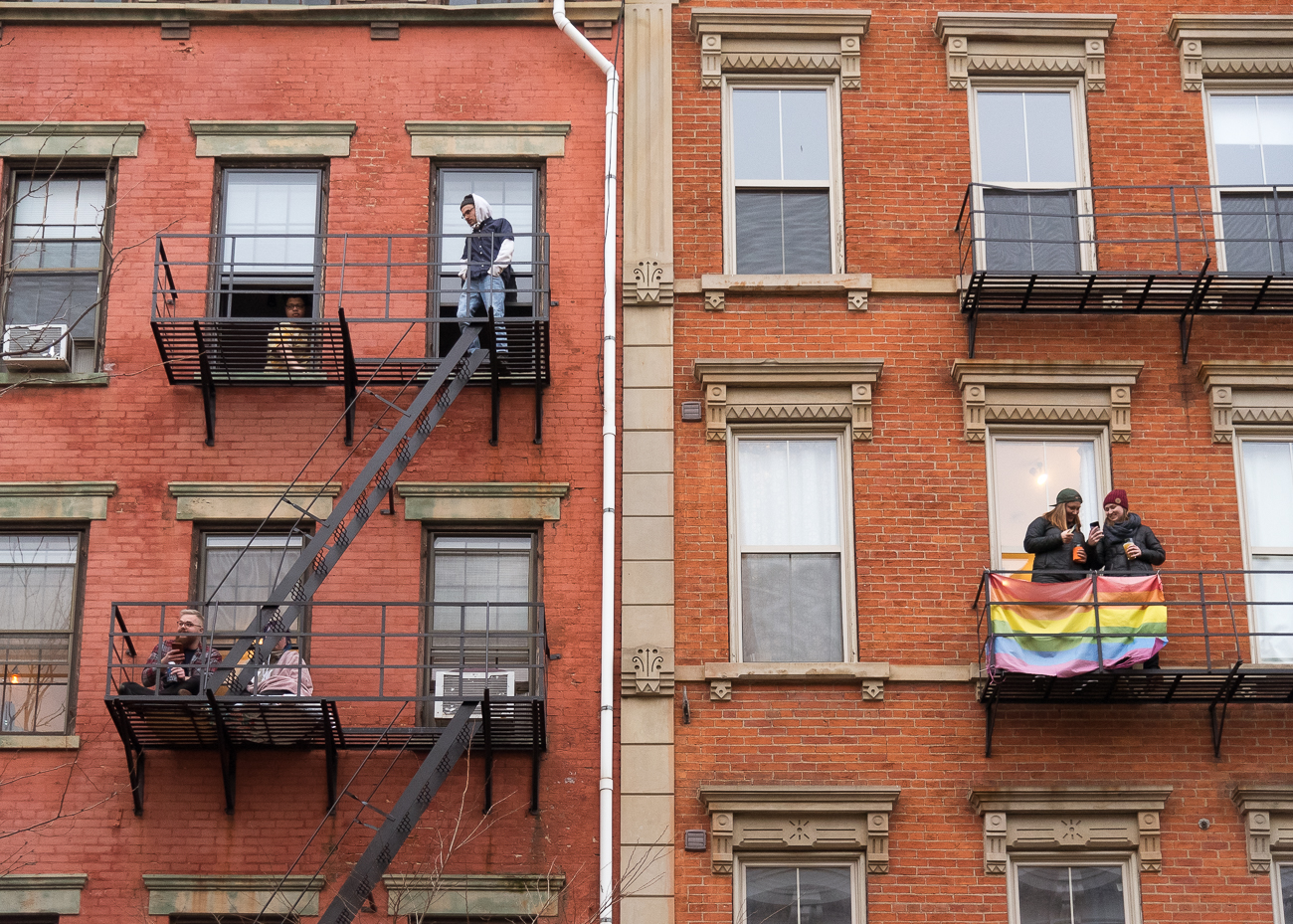 People enjoy the parade from their fire escapes / Image: Phil Armstrong, Cincinnati Refined // Published: 3.2.19