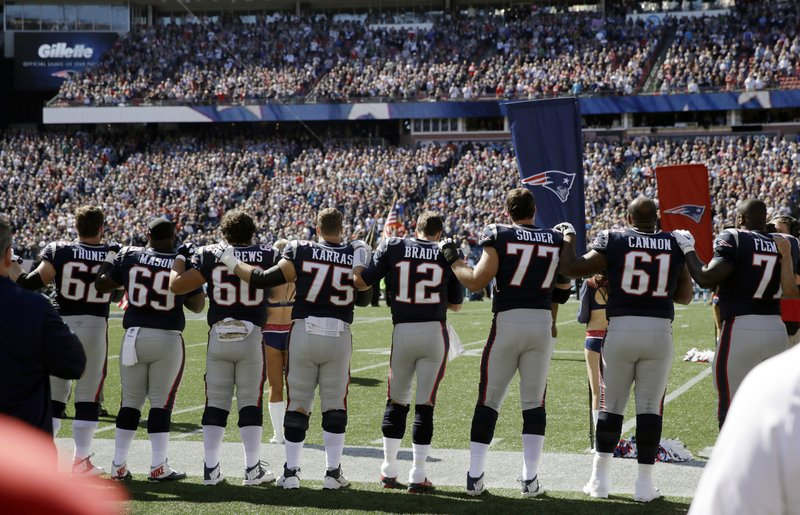 Members of theÂ?New England Patriots stand along the sideline during the national anthem before an NFL football game against the Carolina Panthers, Sunday, Oct. 1, 2017, in Foxborough, Mass. (AP Photo/Charles Krupa)