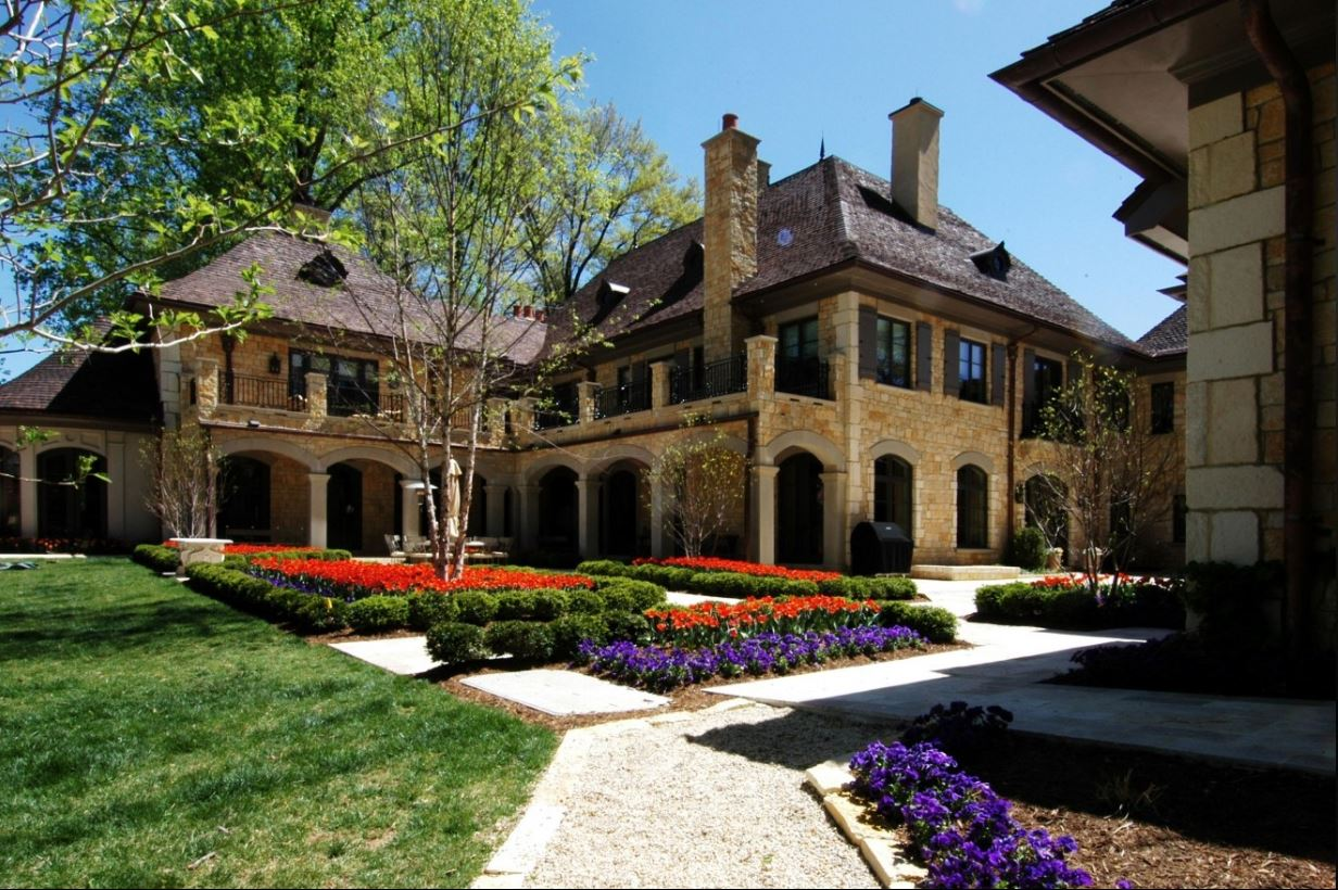 This 6 bedroom/8 bath 20,000-square-foot house is basically real estate heaven. It comes with everything you need -- and plenty that you don't! We're talking eight fireplaces, an eight-car garage, two pools, a basketball court and a wine cellar to die for. (Image: Courtesy TTR Sotheby's International Realty)