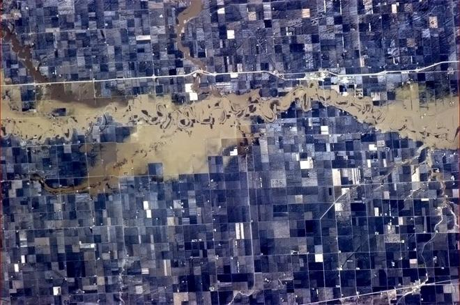 Red River overflowing - Spring floods making a sorry mess between Grand Forks and Winnipeg.  (Photo & Caption: Col. Chris Hadfield, NASA)