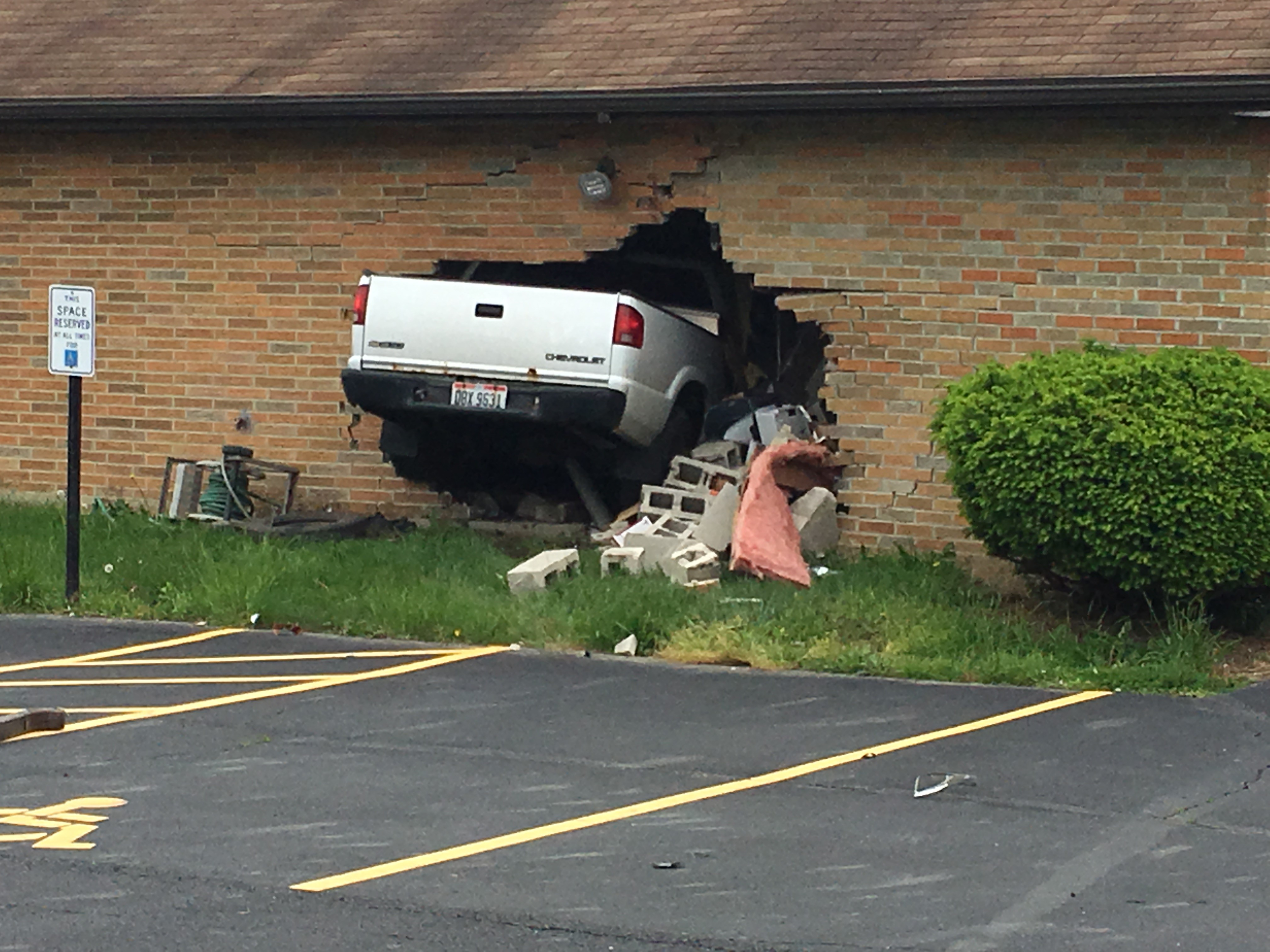 Woman loses control of truck, drives through fences before smashing into Riverside church (WKEF/WRGT)
