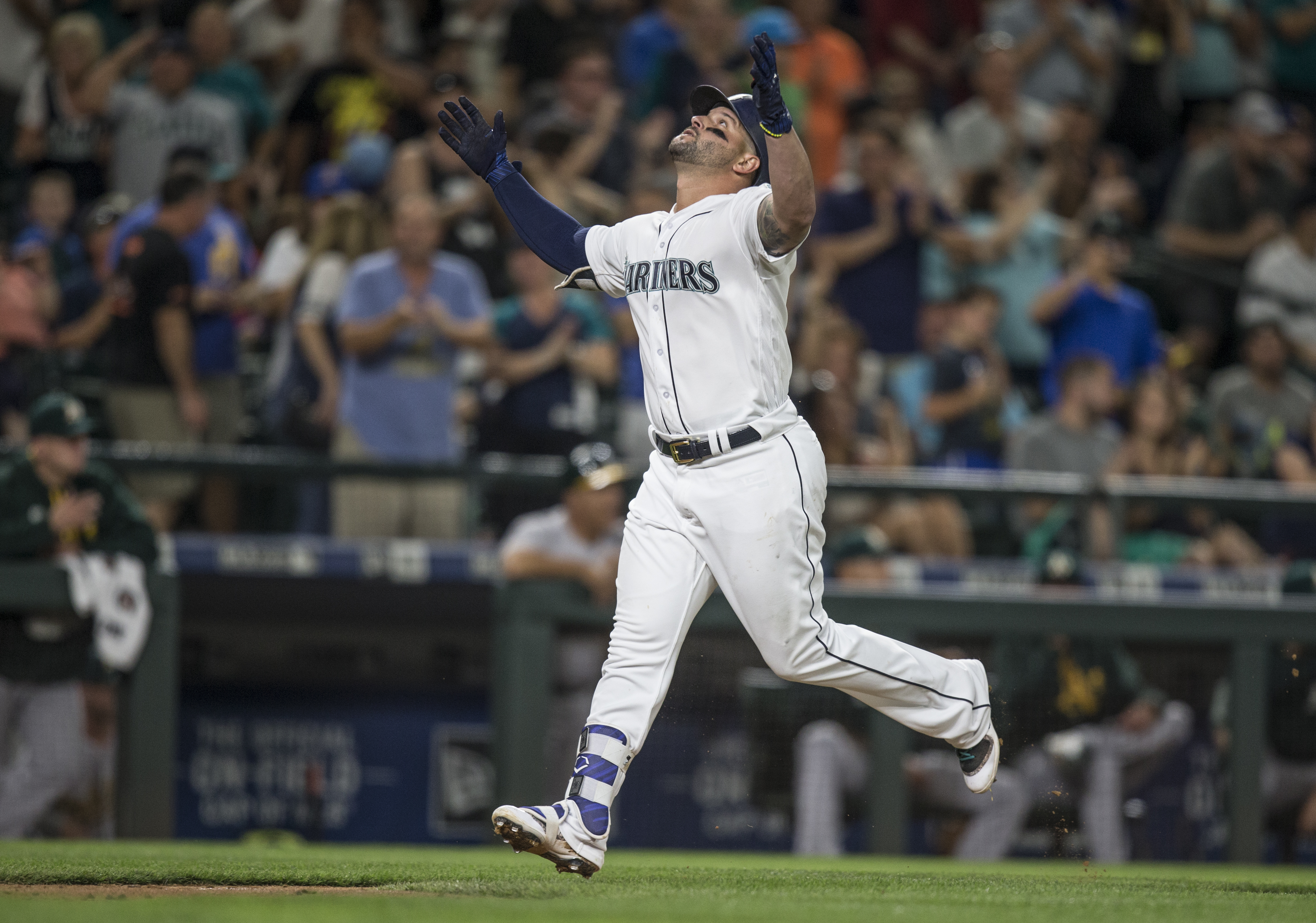 Seattle Mariners' Yonder Alonso celebrates his solo home run off Oakland Athletics starting pitcher Jharel Cotton during the fifth inning of a baseball game on Saturday, Sept. 2, 2017, in Seattle. (AP Photo/Stephen Brashear)