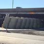 Tractor-trailer rig hauling hay overturns on I-40 near Lakeside Dr.