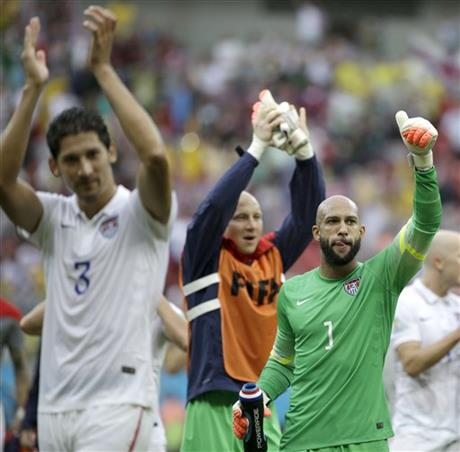 United States' goalkeeper Tim Howard (1) and his teammates celebrate after qualifying for the next World Cup round following their 1-0 loss to Germany during the group G World Cup soccer match between the USA and Germany.