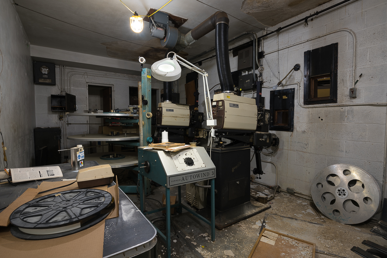 The projection booth features two Simplex projector heads attached to Orcon lamp houses with a single film platter array between them. Since the theater shuttered in the late-1990s, the room appears to have been largely left untouched. Today, it's a sort of old-world cinema time capsule from two decades before. / Image: Phil Armstrong, Cincinnati Refined // Published: 2.22.18