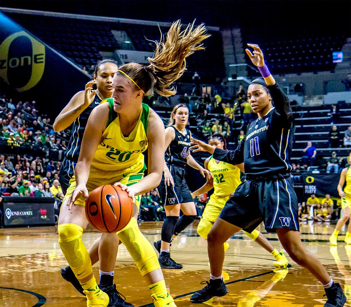 The Duck's Sabrina Ionescu (#20) looks for a path to the basket around the Huskies. The Oregon Ducks defeated the Washington Huskies 94-83 on Sunday at Matthew Knight Arena. The victory was Head Coach Kelly Graves' 500th career win. Sabrina Ionescu also set the new NCAA all time record of 8 triple doubles in just 48 games. The previous record was 7 triple doubles in 124 games, held by Susie McConnell at Penn State. The Ducks will next face off against USC on Friday January 5th in Los Angeles. Photo by Rhianna Gelhart, Oregon News Lab