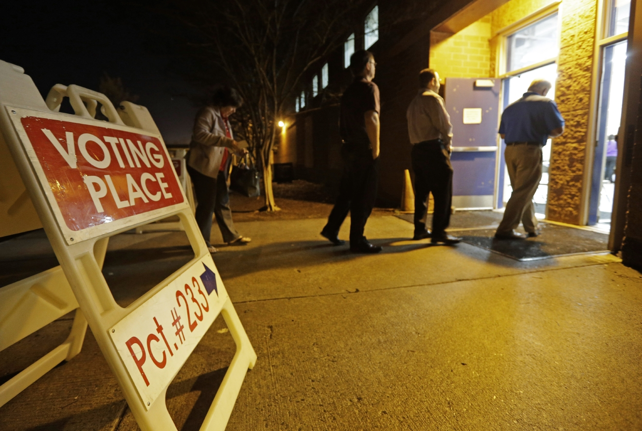 People line up to vote at a precinct in Matthews, N.C., Tuesday, March 15, 2016. Voters in North Carolina, as well as Florida, Illinois, Missouri and Ohio will cast their ballots in primary elections today. (AP Photo/Chuck Burton)
