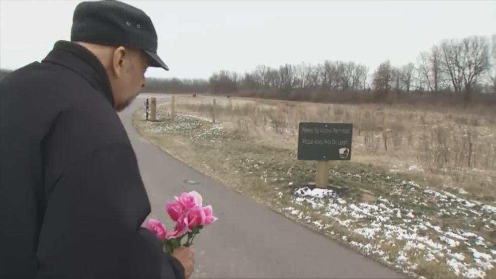 A man stopped by the  Scioto Grove Metro Park in Grove City to leave flowers for slain OSU student Reagan Tokes. (WSYX/WTTE)