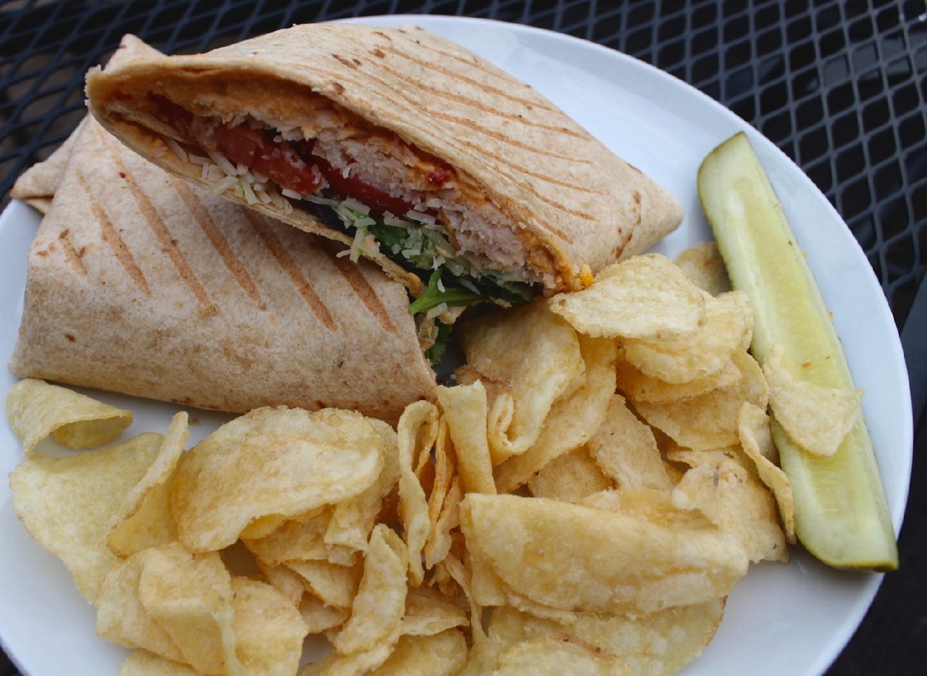 The Chuck Norris: chipped turkey, roasted red pepper hummus, avocado, parmesan, lettuce, tomato on a wheat wrap served with chips and a pickle / Image: Rose Brewington