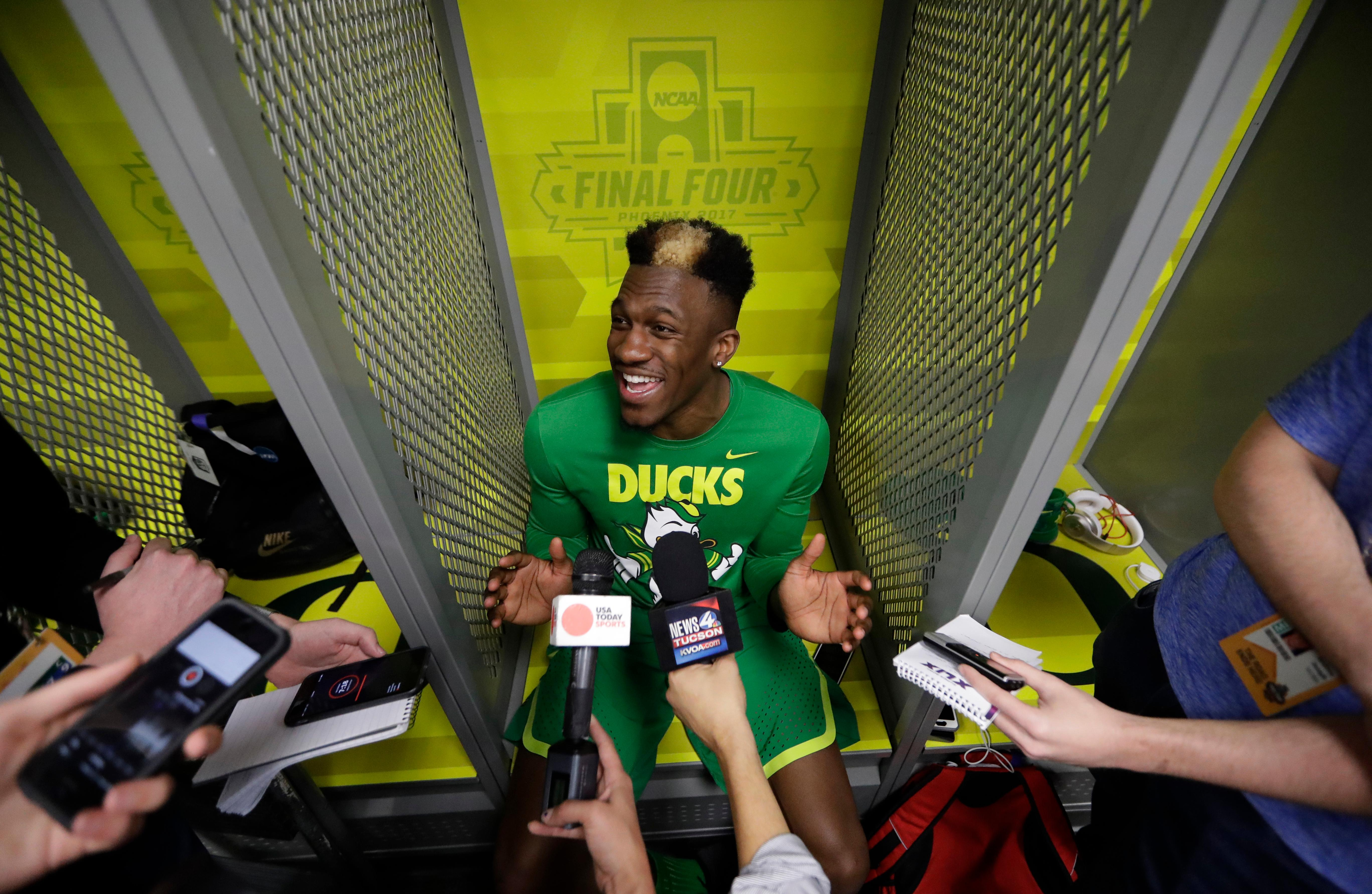 Oregon's Dylan Ennis answers questions after a practice session for their NCAA Final Four tournament college basketball semifinal game Thursday, March 30, 2017, in Glendale, Ariz. (AP Photo/David J. Phillip)