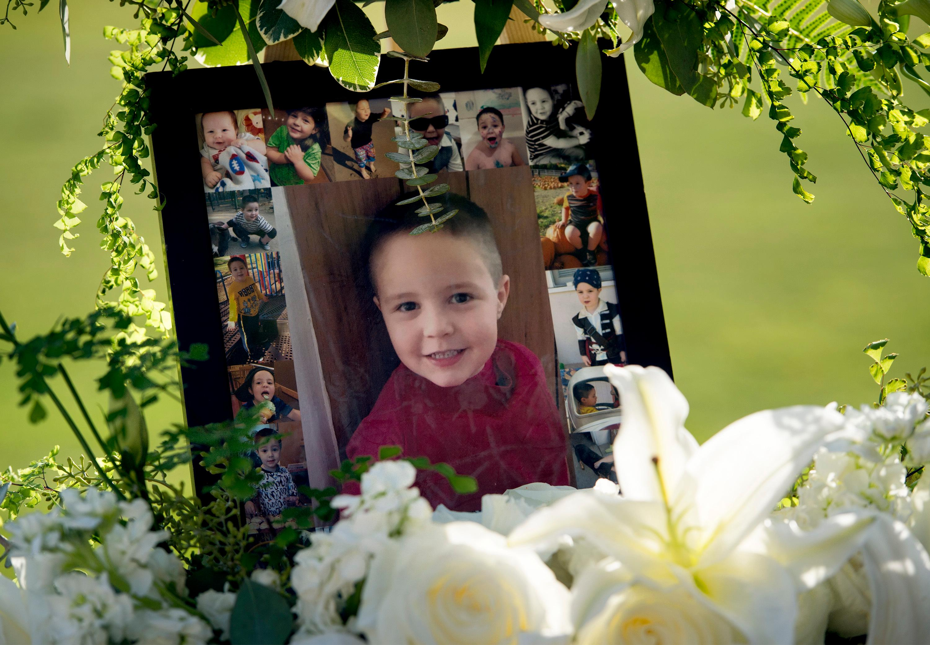 FILE - This July 19, 2017 file photo shows a portrait of five-year-old Aramazd Andressian Jr. at a memorial in his memory at the Los Angeles County Arboretum in Arcadia, Calif. Aramazd Andressian Sr. has pleaded guilty to killing his 5-year-old son. Andressian Sr. entered the plea to first-degree murder Tuesday, Aug. 1, 2017 in Los Angeles County Superior Court in Alhambra, Calif. He previously pleaded not guilty to a murder charge and was being held on $10 million bail. (Leo Jarzomb /Los Angeles Daily News via AP, file)