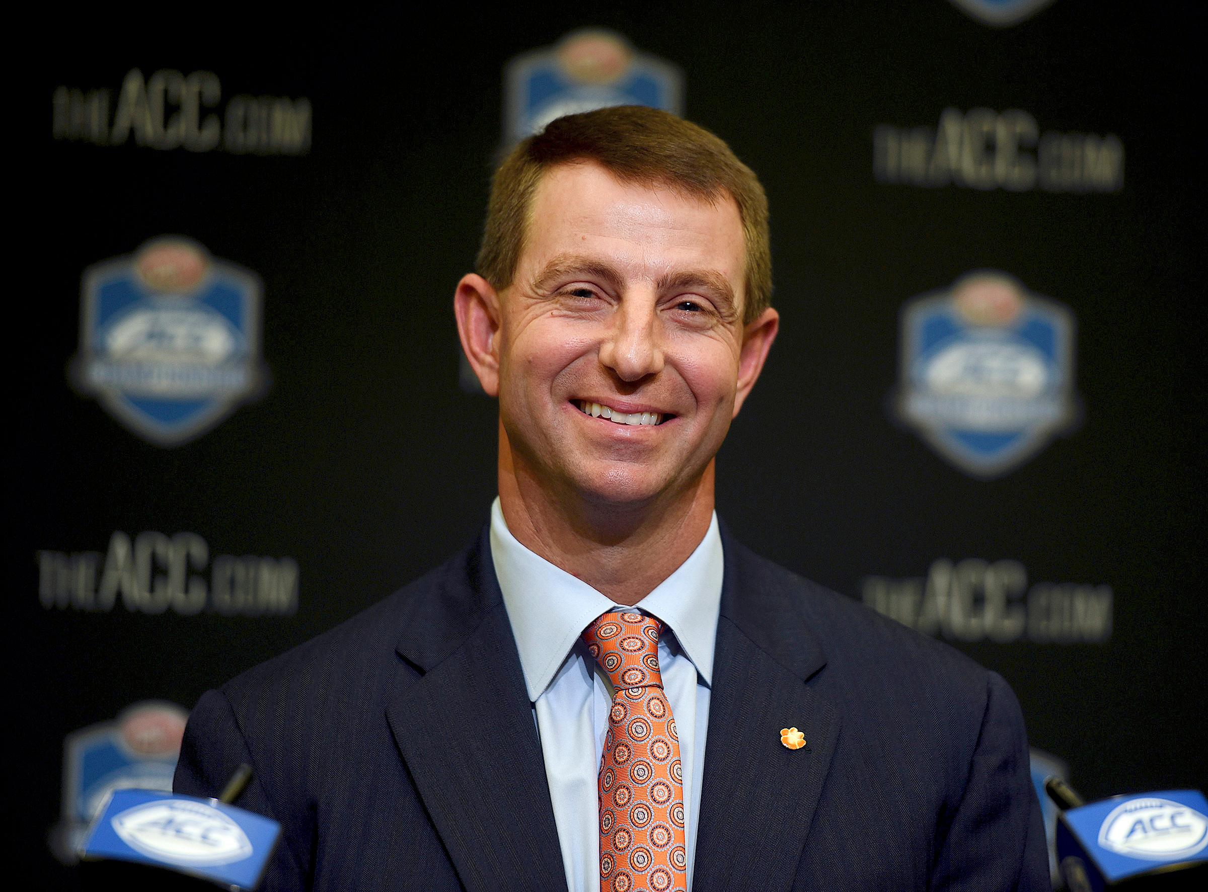 FILE - In a Dec. 1, 2017 file photo, Clemson coach Dabo Swinney smiles during an NCAA college football press conferences for the Atlantic Coast Conference championship game against Miami at Bank of America Stadium. Swinney, UCF's Scott Frost and Georgia's Kirby Smart are the finalists for The Associated Press Coach of the Year award. The winner will be announced Monday, Dec. 18. (Diedra Laird/The Charlotte Observer via AP, File)