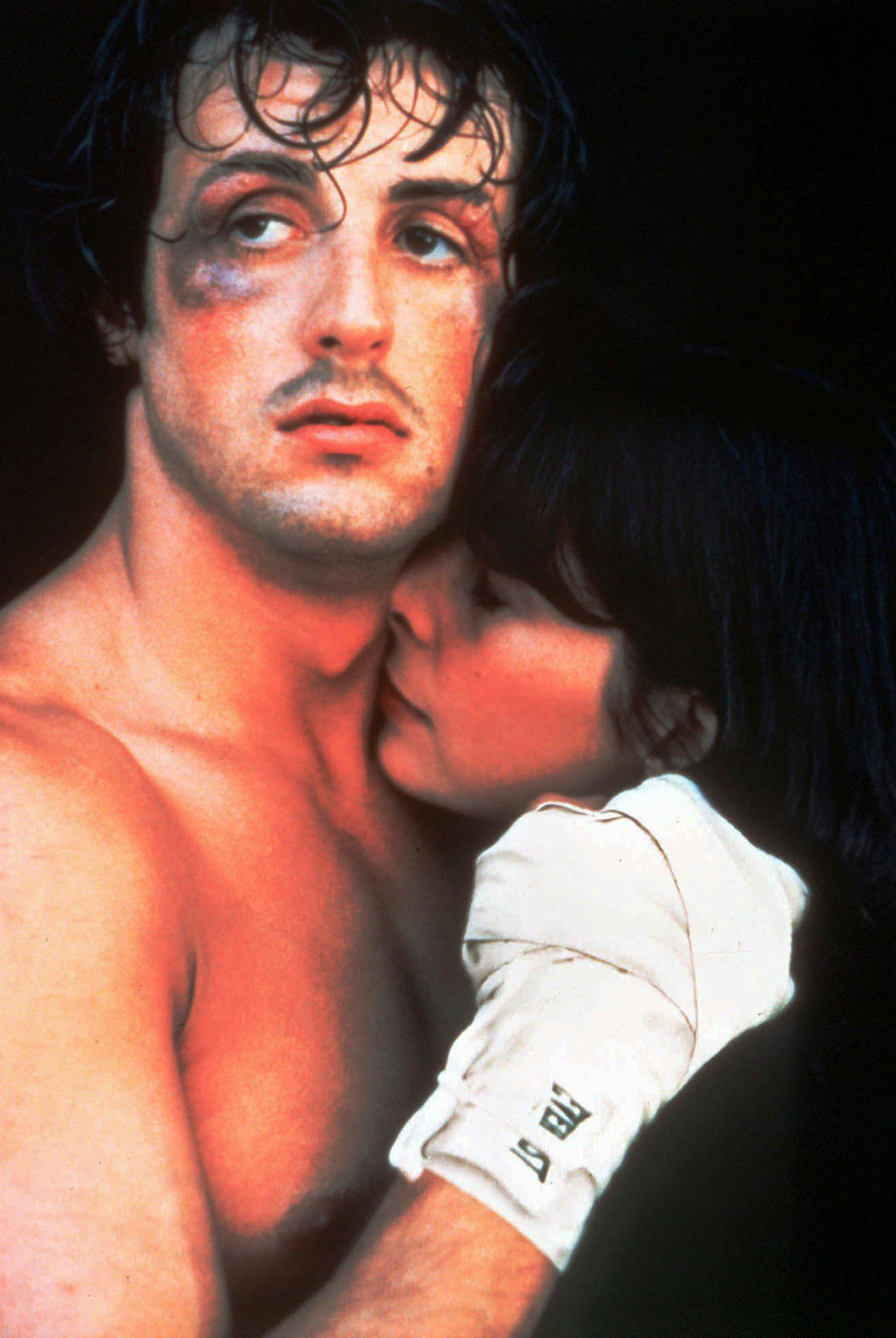 "FILE – Actor and screenwriter Sylvester Stallone holds actress Talia Shire in a scene from the 1976 movie ""Rocky."" Four decades after the Nov. 21, 1976, premiere of ""Rocky,"" the movie's reach is international, and the title character's underdog tale of determination, grit and sleepy-eyed charm still resonates with fans. (AP Photo, File)"