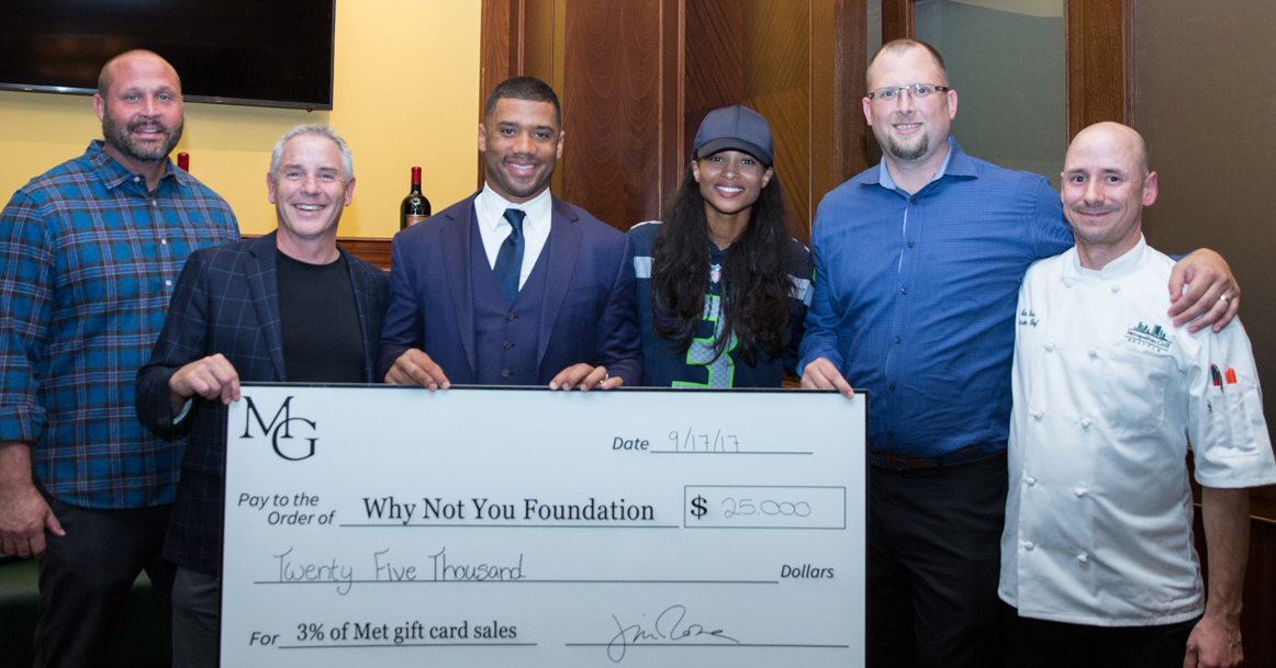 Russell Wilson and Ciara accept $25K check from Metropolitan Grill in new partnership (Image courtesy of the Met Grill)