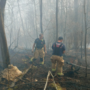 Chattanooga firefighters work to put out brush fire in Hixson Friday afternoon