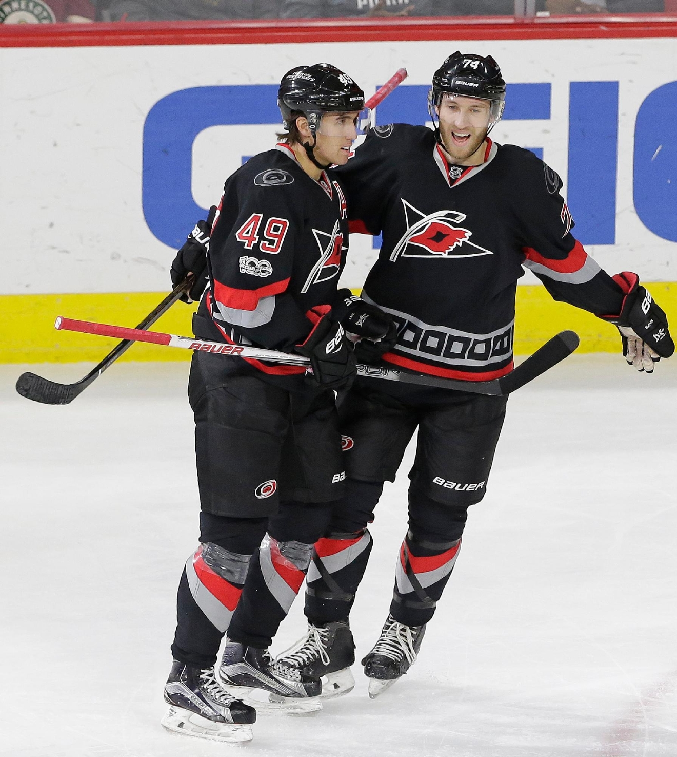 Carolina Hurricanes' Victor Rask (49), of Sweden, is congratulated by Jaccob Slavin (74) following Rask's game-winning goal against the Minnesota Wild during the third period of an NHL hockey game in Raleigh, N.C., Thursday, March 16, 2017. Carolina won 3-1. (AP Photo/Gerry Broome)