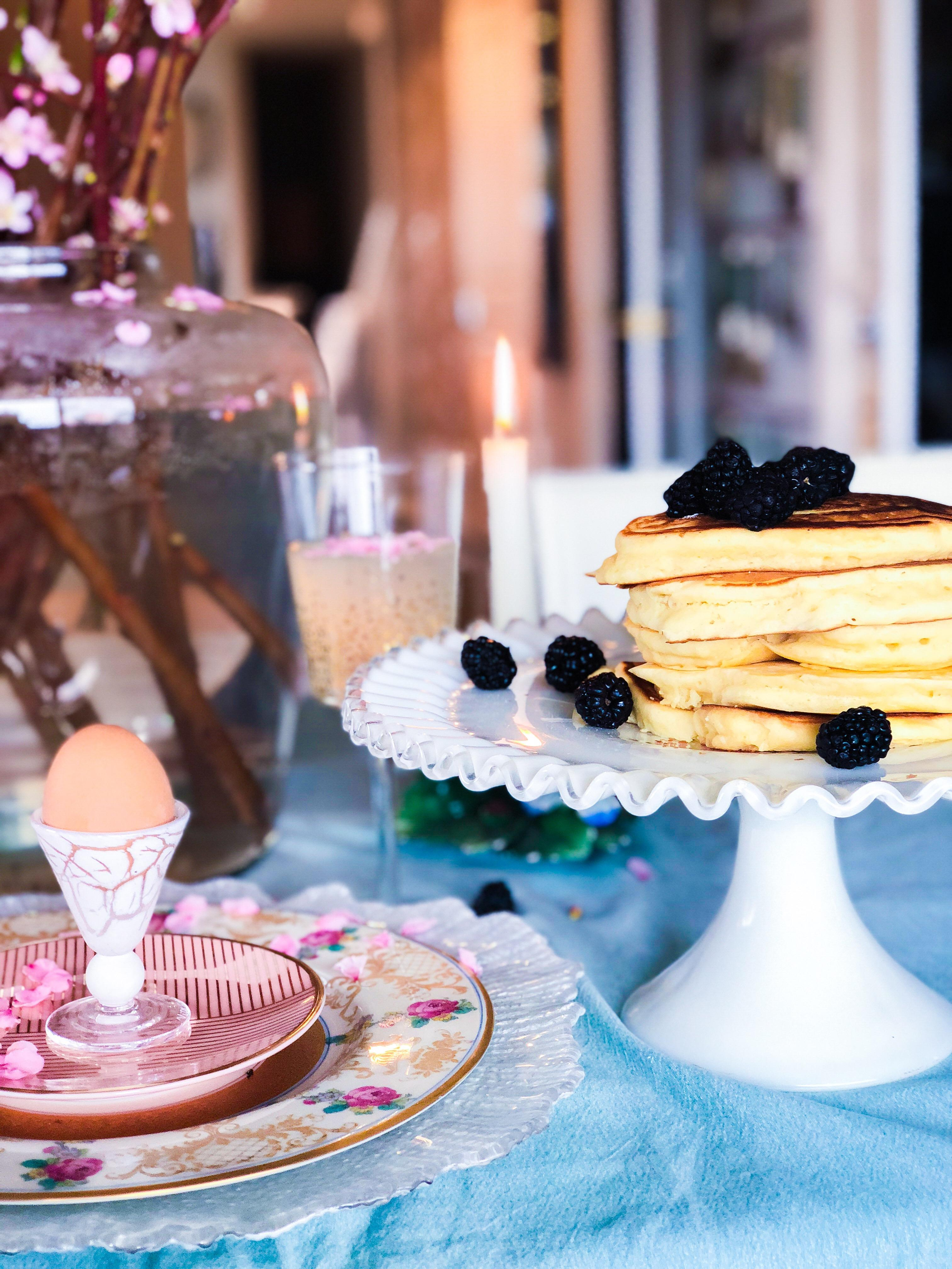 I always make homemade buttermilk pancakes with soft boiled eggs, fresh fruit and bacon -- simple and easy. But you can make whatever you like as the the food takes a back seat. It is really the table decor that elevates this romantic brunch.{ } (Image: Ashley Hafstead)