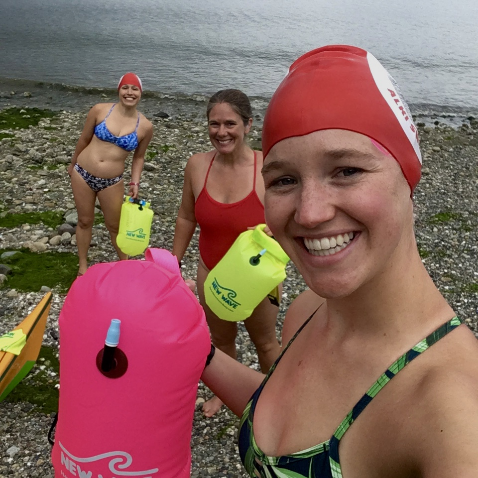 Fellow Notorious Alki Swimmers Rose Filer and Stephanie Zimmerman join Danielson on a swim from Battlepoint into Manzanita Bay. (Image:{ }Kelly Danielson)