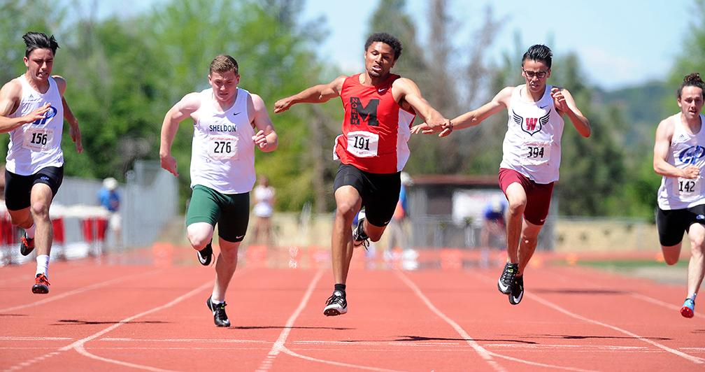 Andy Atkinson / Mail TribuneNorth Medford's Kaison Faust (191) gets to the line ahead of the field winning the 100-meter dash at the SWC Championships meet at North Medford High School Saturday.
