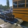 Car crashes into back of school bus, gets stuck in Vancouver
