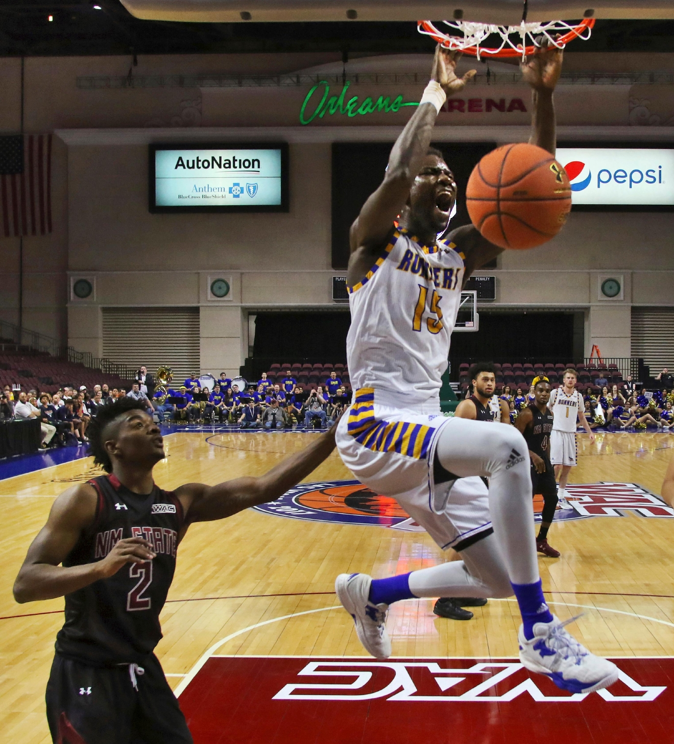 Cal State Bakersfield center Fallou Ndoye dunks on a fast break during the second half of an NCAA college basketball game in the final of the Western Athletic Conference tournament Saturday, March 11, 2017, in Las Vegas. New Mexico State won 70-60. (AP Photo/L.E. Baskow)