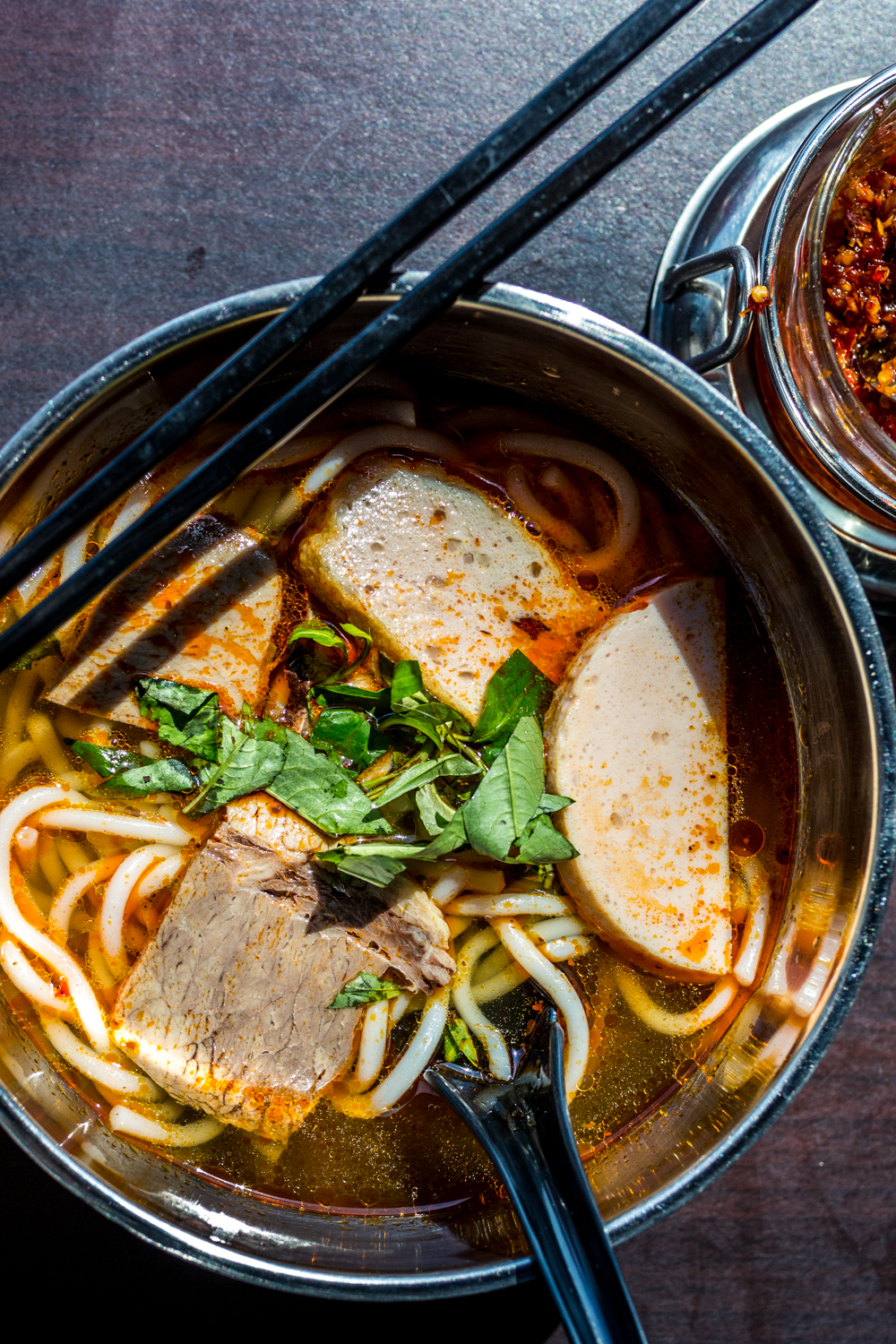 Spicy Beef Noodle Soup: rice noodles in a spicy lemongrass broth with beef slices, Vietnamese ham, soft tendon, cilantro, green onions, and white onions / Image: Catherine Viox{ }// Published: 9.28.19