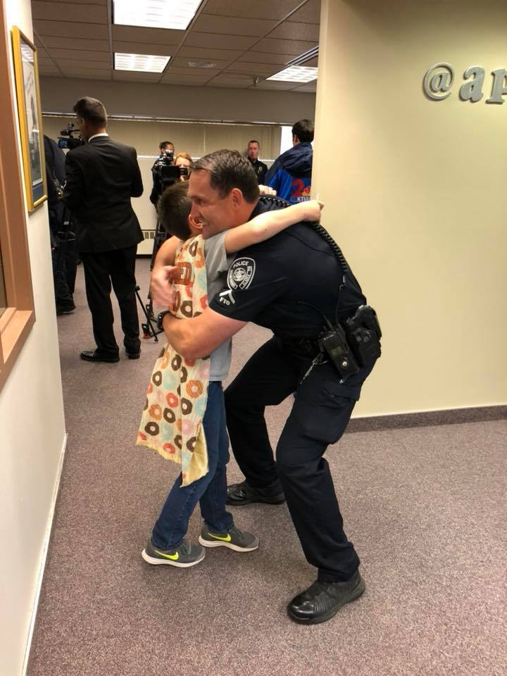 "Not all heroes wear capes, but that's not the case when talking about 10-year-old Tyler Carach. He proudly wears a cape that states his BOLD mission: ""I DONUT need a reason to thank a cop."""