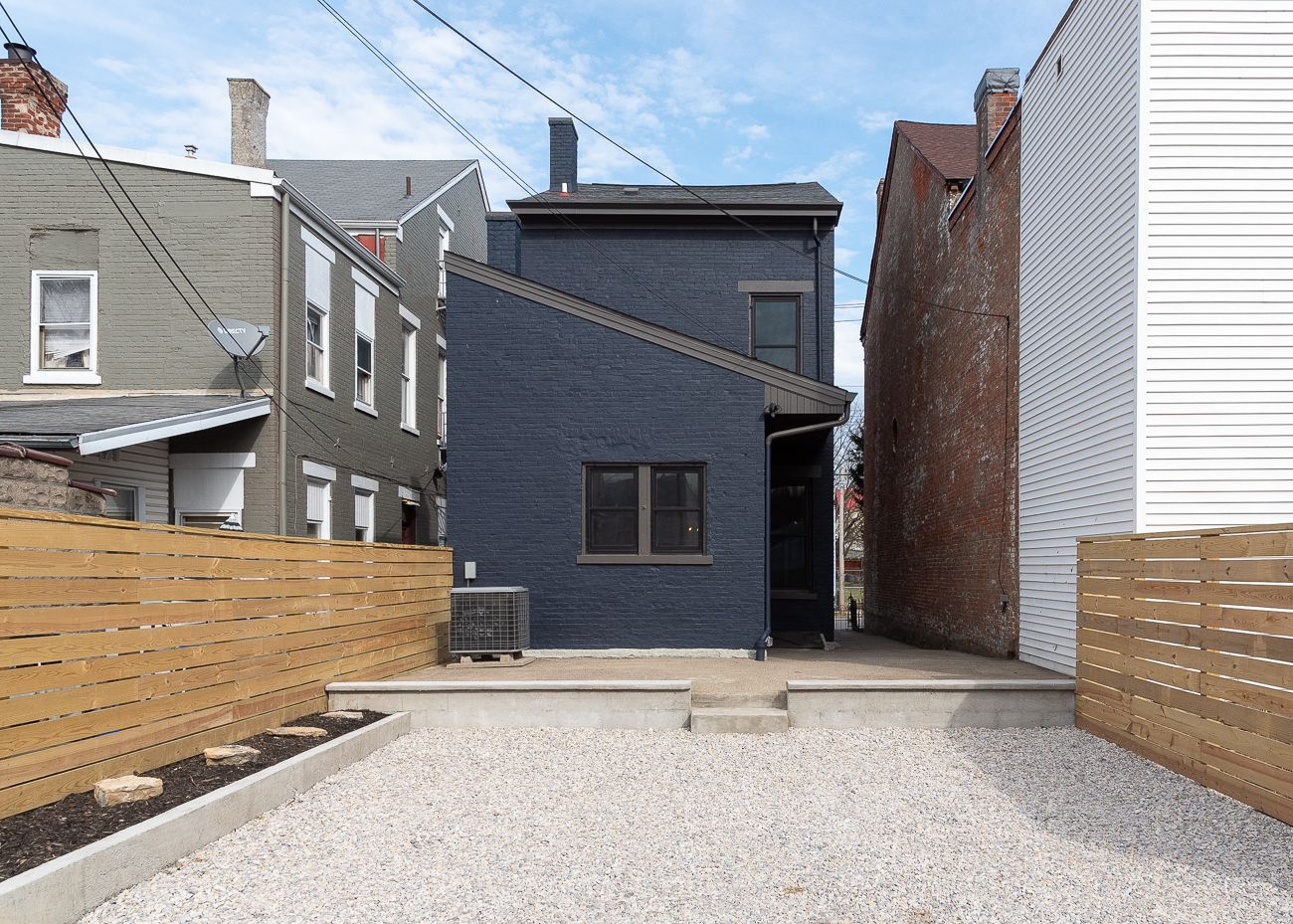 The rear of the house sports a modest patio and a two-car parking spot accessible via an alley. / Image: Phil Armstrong, Cincinnati Refined // Published: 3.15.19