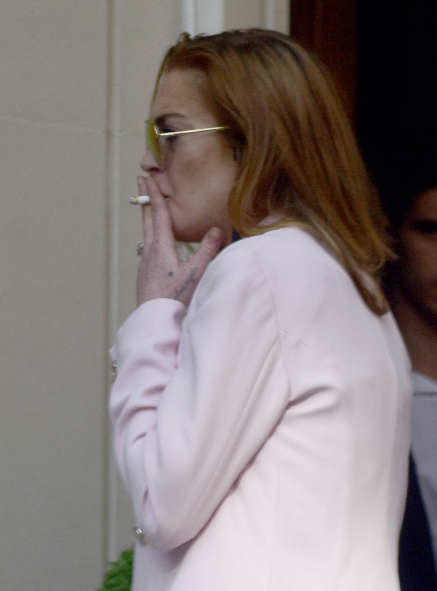 Lindsay Lohan seen in pink blazer outside a hotel smoking                                    Featuring: Lindsay Lohan                  Where: London, United Kingdom                  When: 23 Jun 2015                  Credit: WENN.com